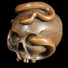 Unusually large fine carved wood okimono of a human skull entwined with a snake Japanese circa 1890    Maker  Signed Dai Nihon Sukeyuki zo    Date  Meiji period, circa 1890