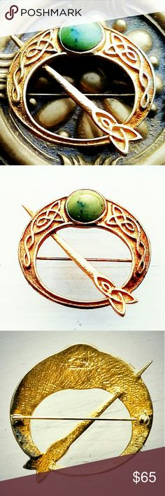 Vintage Irish Tara Connemara Stone Gold Brooch Vintage Irish Tara Connemara Stone Gold Brooch. Lovely signed  brooch, but I can't make out the signature. In very good vintage condition, with light oxidation on the back of the brooch. Vintage Jewelry Brooches