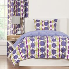 Overlapping vibrant baubles layer and drape to reveal yourstylish personality in this fun comforter set. A solid purple back reverse completes the look. This polyester set is conveniently machine washable.
