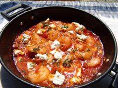 Shrimp Saganaki is served as an appetizer, and is accompanied by ouzo or wine. It is easy to prepare and if you like nibbling seafood with a glass of wine, this will be your dish! Saganaki is the special small pan with two handles that is used for pr Turkish Recipes, Greek Recipes, Fish Recipes, Seafood Recipes, Ethnic Recipes, Shrimp Saganaki Recipe, Cookbook Recipes, Cooking Recipes, Prawn Fish