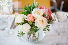 fishbowls of open coral and cream roses, cream david austen roses, watermelon dahlias, bouvardia, privet berry The reef restaurant Terrigal, Central coast