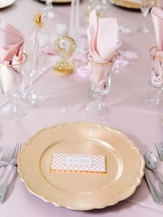 Blush and gold summer reception table setting - gold plates on pink table cloth + napkins