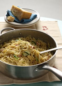 8 ounces dried spaghetti  3 ounces pancetta or bacon, diced  1/4 cup finely chopped shallots  3 large eggs, lightly beaten  1 medium zucchini, cut into ribbons  1/2 cup grated Parmigiano Reggiano cheese  1/4 cup half-and-half  1 teaspoon salt  -- Coarsely ground black pepper, divided