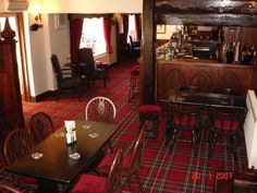 Love this red tartan rug in The Blue Bell pub.  I want this for my living room!