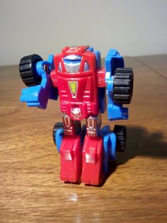 Transformers: Gears. Another mini Autobot. I remember these were 2.69$ at Best. Not Best Buy... Best. It was a department store in Akron, OH. Another little-known fact is that Gears teamed up with Spiderman in the only superhero crossover for the Marvel Transformers comic book.