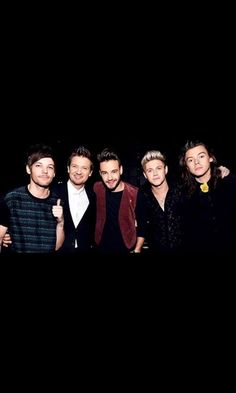 Jeremy Renner with One Direction group