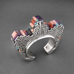Gorgeous bracelet!  inlaid stepped bracelet with turquoise, sugilite, red coral, pink coral, lapis and opal by hank whitethorne, available at wright's indian art