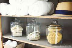 Glass jars filled with natural sponges and starfish | Cabinet painted in chalk paint in French Linen