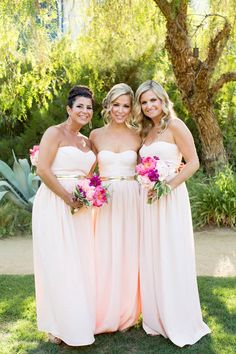 Bridesmaids in pale pink with deep pink bouquets -- see more on SMP: http://www.StyleMePretty.com/2014/03/06/colorful-palm-springs-wedding/ Jen Lauren Grant From Birds Of A Feather Photography
