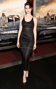 Anne Hathaway looking flawless in a simple fitted dress with pointed-toe pumps
