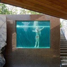 Bizarre entrance ~ A huge window in one side of the pool offers swimmers a view of the home's entrance when they are underwater. From here, they can greet visitors or put on a dazzling underwater show. #Bizarre4home