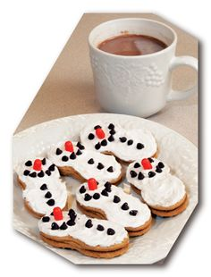 A fun winter snack for the kids. Snowman cookies made from Nutter Butter cookies and a simple homemade hot cocoa recipe.