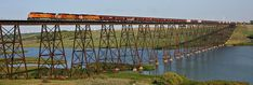 A BNSF train crosses Lake Ashtabula on the Sheyenne River west of Luverne, North Dakota. The 2,736 ft Sheyenne River Bridge was erected in 1912 by the Great Northern Railway. The North Country Trail, a 4,600 mile recreational trail, passes beneath the bridge