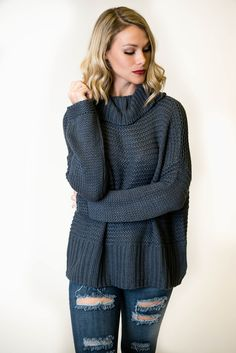 Fall favorite! Adorable soft knit sweater has a foldover turtleneck detail that slits open in the back to create a slouchy look. The oversized fit is perfect for pairing with skinnies or leggings this