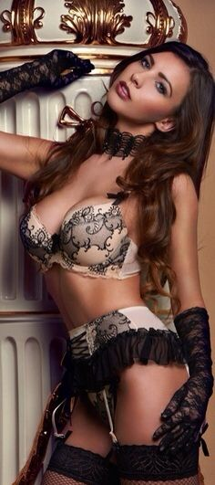Pretty lingerie on a pretty brunette. I like the gloves & choker.