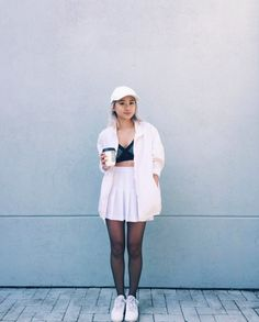 Jasmine C. wears our Tennis Skirt to stay true to the black and white #ootd.
