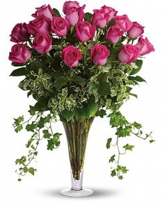 awesome Dreaming in Pink, Make a statement! This lush arrangement of hot pink roses and gracefully trailing ivy can be a fabulously romantic gift, or a fun-filled gift for a girlfriend. ,  http://sendflowerstocalgary.com/product/dreaming-in-pink-send-flowers-to-calgary-by-calgary-flowers/, 127.95