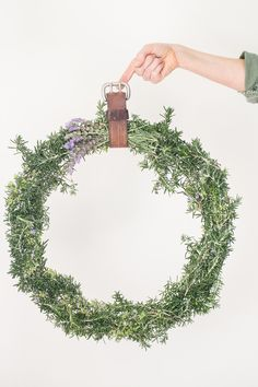 DIY rosemary wreath - LOVE IT!  Could make a small one for the kitchen - excellent way to use up my huge rosemary plant!
