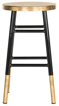 A classic silhouette gets an on-trend update in the Elise Counter Stool, an eclectic addition to any kitchen island or home bar. The stool's chic black lacquer is set off by its gold-dipped legs and s
