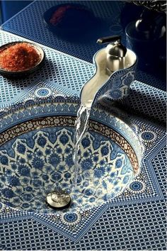 I love the creamer-inspired faucet on this blue patterned sink. It feels British and Moroccan all in one.