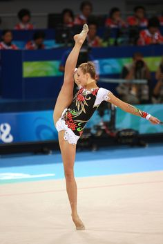 August 22, 2008; Beijing, China; Rhythmic gymnast Inna Zhukova of Belarus performs with clubs on way to winning silver in the All-Around final at 2008 Beijing Olympics..(©) Copyright 2008 Tom Theobald