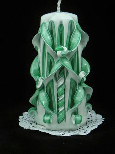 Check out this item in my Etsy shop https://www.etsy.com/listing/210303655/hand-carved-candle-green-and-white