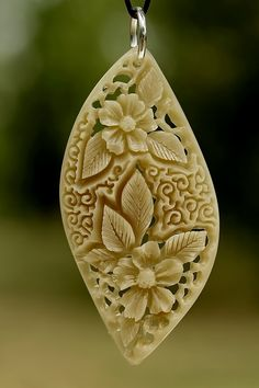 pendant 2 - bone carving by ~manuroartis