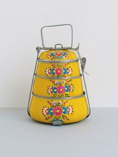 Our beautiful hand-painted 3-tier Modern Tiffin Carrier is a great way to bring homemade food with you. A modern take on a traditional classic.