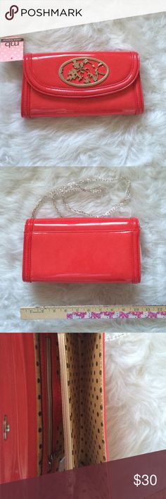 Melie Bianco Felice Purse NWT. Has cute bird and leaves emblem on the front. Coral color. Has silver colored chain strap to convert it in to shoulder bag. Magnetic closure. Offers and questions are welcome. No trades. Melie Bianco Bags