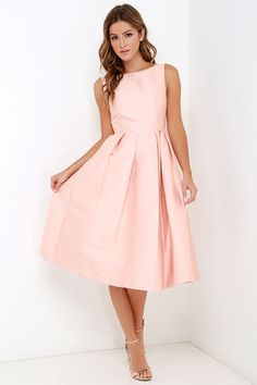 Like a tree that never loses its leaves, the Elliatt Evergreen Blush Midi Dress will stay stylish through the trends! Sleeveless, expertly tailored bodice with a feminine bateau neckline, tops off this silky, woven dress in a darling peachy shade. Fitted waistline introduces a full, pleated midi skirt worthy of any elegant gathering. Hidden gold back zipper. Fully lined. Self: 47% Polyester, 47% Cotton, 6% Nylon. Contrast: 100% Nylon. Lining: 100% Polyester. Dry Clean Only. Imported.