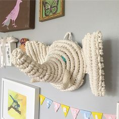Meet HENRY...my very first macrame elephant. A friend of mine wanted to commission a piece from me for someone who recently had a baby boy. After showing a picture of the baby room, which had beautiful elephant wallpaper on one side, I asked her if I can try to make an elephant macrame piece since I always wanted to make one (since the shop name IS called GREENELEPHANT ) There was no pattern to follow so I winged it. After many changes and uncertainty, I pushed through and Henry was born! I'