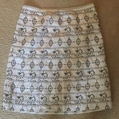 Ann Taylor Loft Skirt A beautifully crafted skirt made with embroidered stitching creating an incredible design and pattern. 55% Linen, 45% Cotton lining, 100% Acetate Decoration, 100% Polyester Ann Taylor Skirts Midi