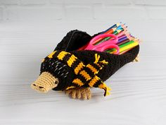Ravelry: Niffler pencil case fantastic beasts character pattern by Svitlana Yakobets Crochet Pencil Case, Pencil Case Pattern, Crochet Case, Crochet Toys, Free Crochet, Crotchet Bags, Crochet Monsters, Crochet Basics, Fantastic Beasts