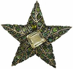 18KT blackened yellow gold bombé star brooch having a large emerald cut citrine at the center and set with various cuts of green tourmaline. Signed Marilyn Cooperman