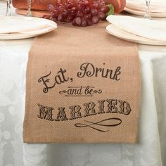 """This unique burlap table runner with the words Eat, Drink and Be Married on both ends. Table runner measures 84"""" x 10"""" for a perfect fit. Visit Kim's Bridal & Gifts for pre orders. http://www.kimsgiftbaskets.com/#sthash.hUOD1cmc.dpbs"""