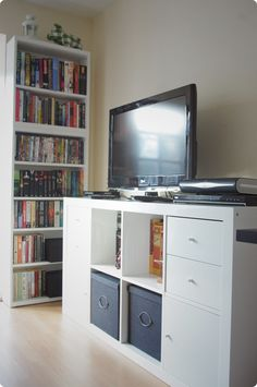 Using Ikea Expedit horizontally creates a TV rack full of storage space!