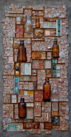 Octaglyph by Jo Braun 27 in h x 14 in w Hand cut salvaged stone tile, plate glass, bottle slices, found objects, and thinset bonding mortar on Wedi© substrate University of Washington Medical Center collection
