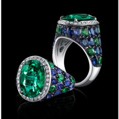 Robert Procop Exceptional Jewels A fine oval green emerald of 4 carats is expert set in handcrafted 18K white gold.  This emerald has been certified as being Zambian in origin.  Surrounded by green oval tsavorite and blue sapphire, these gems create a sea of sparkling vivid green and blue decorating the shank and accented with a frame of white diamond micro pave.