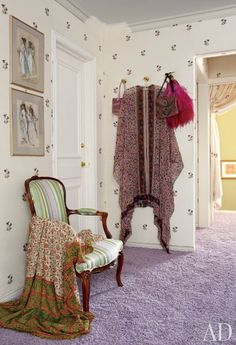 Screen legend Elizabeth Taylor's dressing room in her Beverly Hills home expanded over the years to accommodate her legendary clothes and jewels. An embroidered silk covers the walls; the sketches are Irene Sharaff costume designs for the 1968 film Doctor Faustus, and the purple carpet echoes Taylor's famous violet eyes. (July 2011)