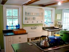 Another rustic/farmhouse style kitchen. I really like the cupboard above the sink.