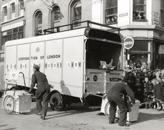 A City Corporation cleansing van clearing up City streets after the 1957 Lord Mayor's Show. Image courtesy of the London Metropolitian Archives.   [spot the man who's legs are hanging outside the van?!]   http://www.cityoflondon.gov.uk/things-to-do/visiting-the-city/archives-and-city-history/london-metropolitan-archives/Pages/default.aspx