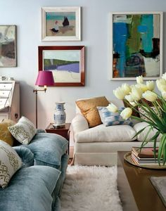 nice living room: light blue & white with accents of gold and bright modern paintings - from apartment therapy