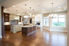 With an incredible kitchen featuring 2 islands, a walk-in pantry and a casual dining area, retreating into the nearby great room after a fantastic family meal and playing games by the fire will become a new family tradition.