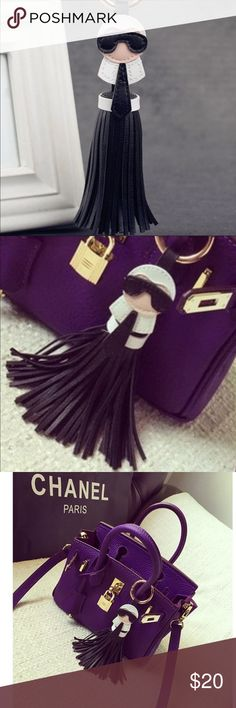 """Karl black fringed luxury fashion keychain Karl L luxury fashion keychain- brand new! A  faux leather black fringed keychain or use it as a handbag charm. Measures 8"""" long. trades.  Offers through offer button only. Thanks! Accessories Key & Card Holders"""