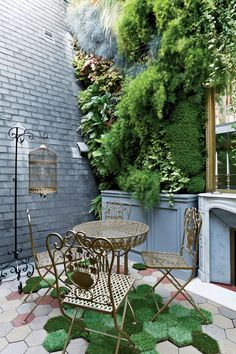 This Parisian pied-a-terre inspired by Le Corbusier features a patio with hexagonal patches of grass scattered between the pavers.
