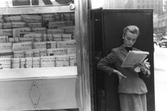 Elbowing an Out of Town Newsstand - 1954.