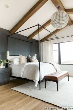 Canopy bed | White bedding | Dark gray accent wall | Wood beams | Modern light fixture #BeddingIdeasMaster