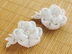 Tiny peonies in white satin and organza - one on a hair clip, one on a brooch pin