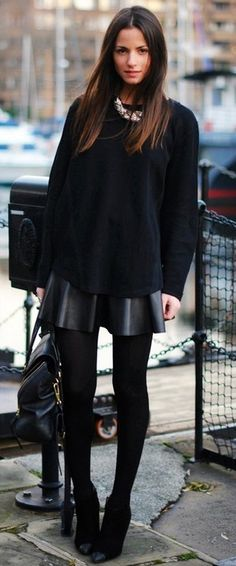 A leather skirt and bold necklace and leather make head to toe black number stand out. Wear opaque black tights with ankle boots to get the effect of longer legs.