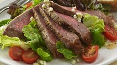 Mustard Glazed Beef Steak Salad.   Pam® Original No-Stick Cooking Spray 1 pound boneless New York strip beef steaks 2 tablespoons Gulden's® Spicy Brown Mustard 1/4 teaspoon coarse ground black pepper 1 pkg (9 oz each) torn mixed salad greens 12 cherry or grape tomatoes, cut in half 1/2 cup light Italian dressing 1/4 cup crumbled blue cheese 4 slices (3/4-inch thick) French bread  1. Preheat broiler. Spray rack of broiler pan with cooking spray. Place steaks on rack. 2. Spread half of…